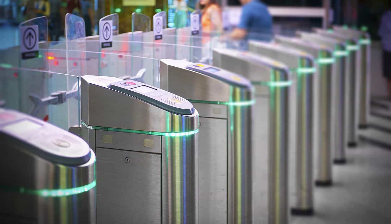 View on Moscow Metro station ticket barriers with green light for entry showing facial recognition payment system
