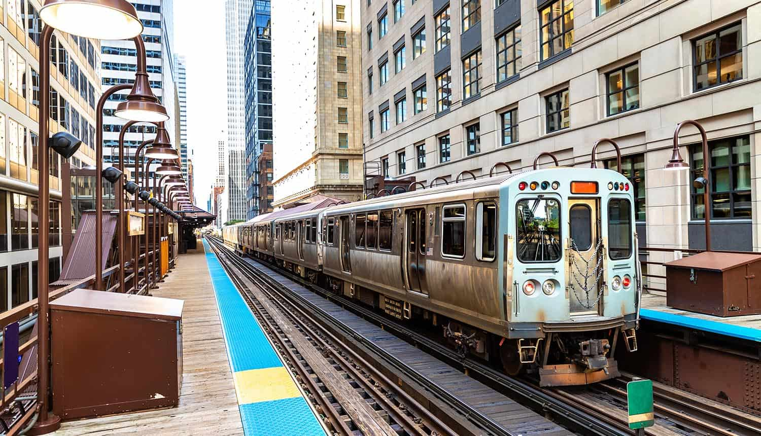 Train subway in Chicago on a sunny day showing cybersecurity regulations on rail and aviation