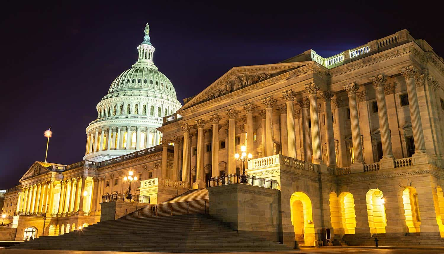U.S. Capitol building at night showing cyber incident reporting bill for ransomware payments